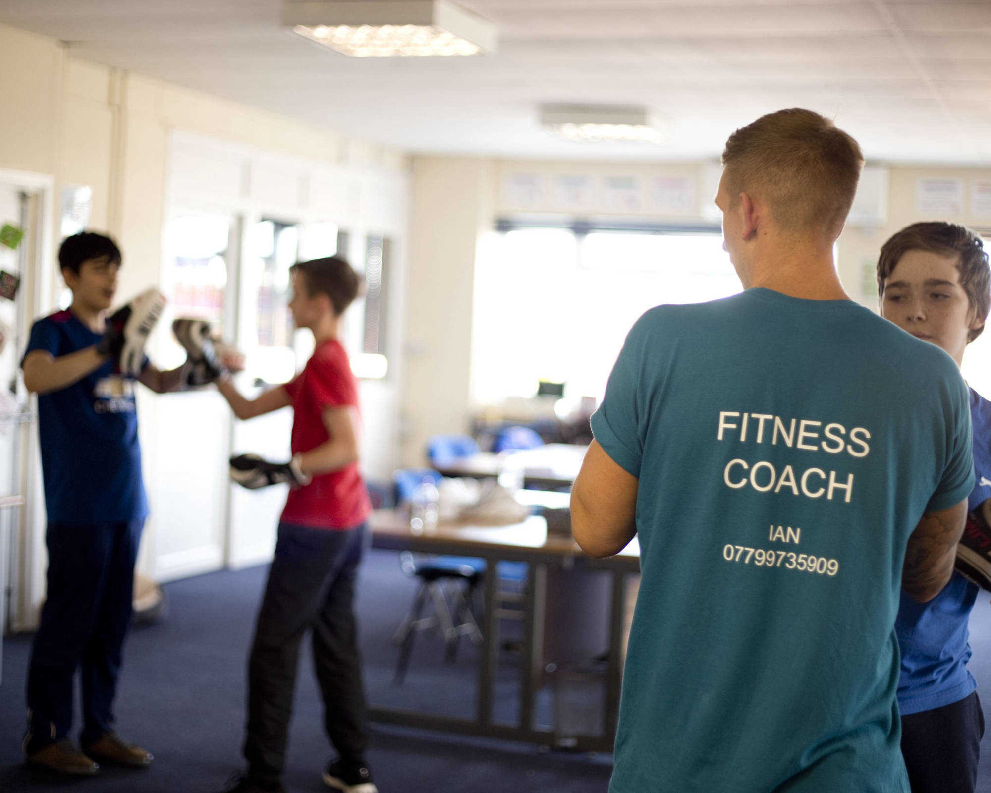 Fitness Coach teaching children